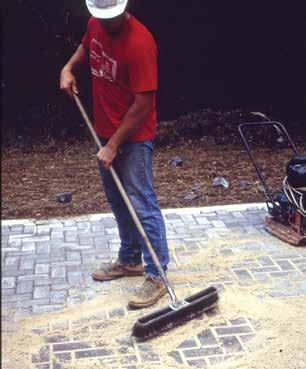 Their elevations should be checked prior to placing the sand and pavers. Edge restraints are typically installed before the bedding sand and pavers are laid.