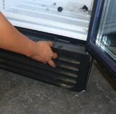 Failure to clean the condenser at regular intervals may cause failure of the refrigeration system and could void the warranty. 1 Remove the rubber cap from the front Grill.