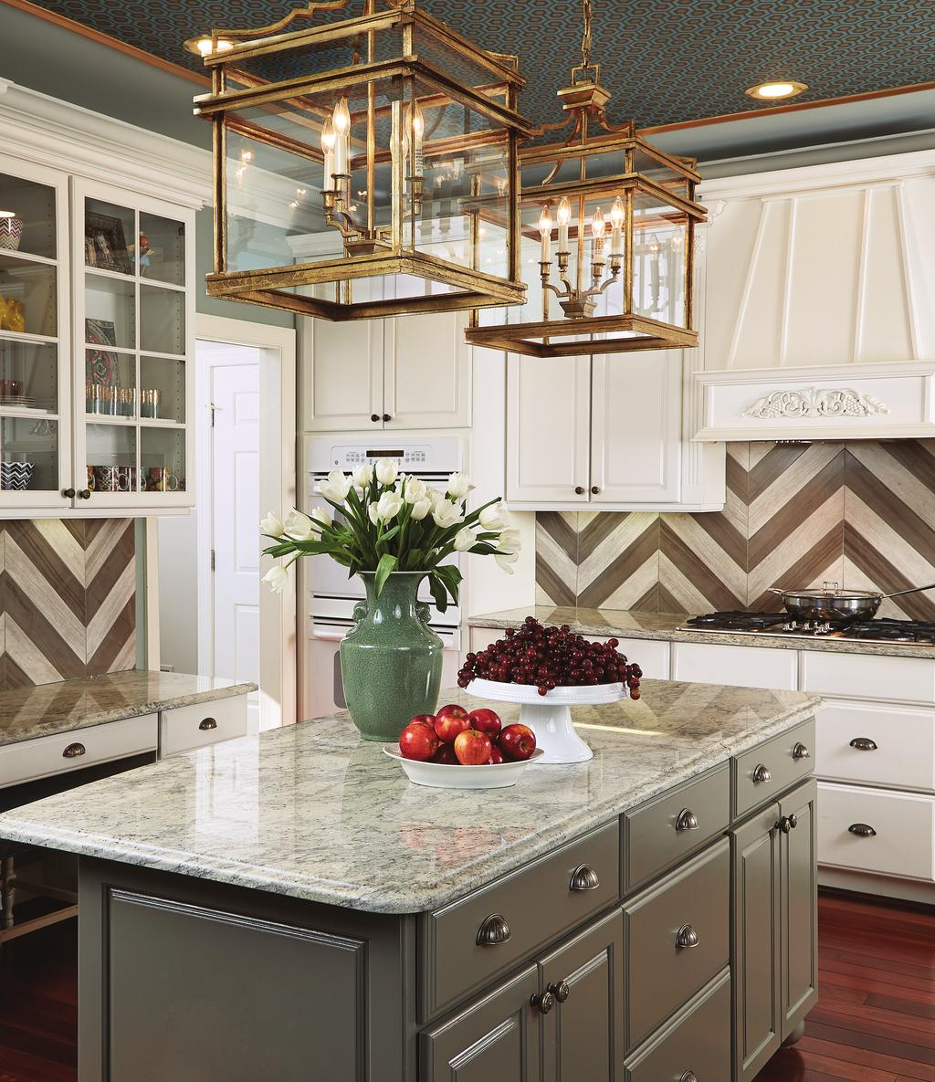 The kitchen s cabinetry and countertops were retained, but the chevron backsplash (which echoes the pattern of the flame-stitch fabric in the great room) was added, as was the ceiling