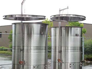 Wine Fermenters. Automatic punch-down vessels in production.