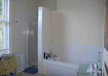 HOUSE BATHROOM This spacious room has a panelled bath, separate shower cubicle, close coupled wc with top flush and pedestal wash hand basin with