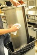 Remove each lane Crumb Tray and empty bulk food debris into trash container