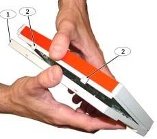 Using a small flat-bladed screwdriver, gently push the two bottom tabs up and in to release the