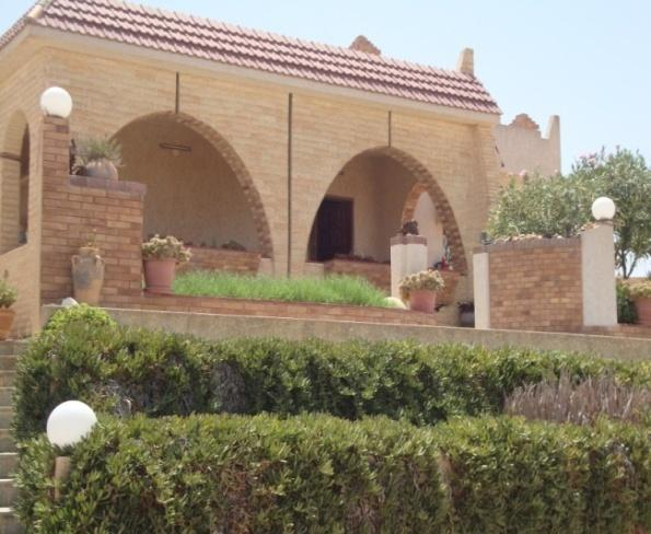 can be found in a contemporary house in Tripoli, with the same utility rooms and the same structure. It is surrounded by external gardens and a fence for protection.