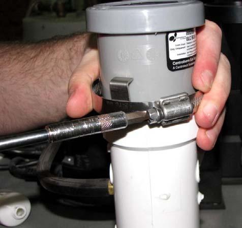 the Flue Clamp over the Air Intake Pipe Tee vent models, install the PVC adapter into
