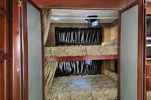 The residential sliding doors provide extra privacy and each bunk comes with an optional