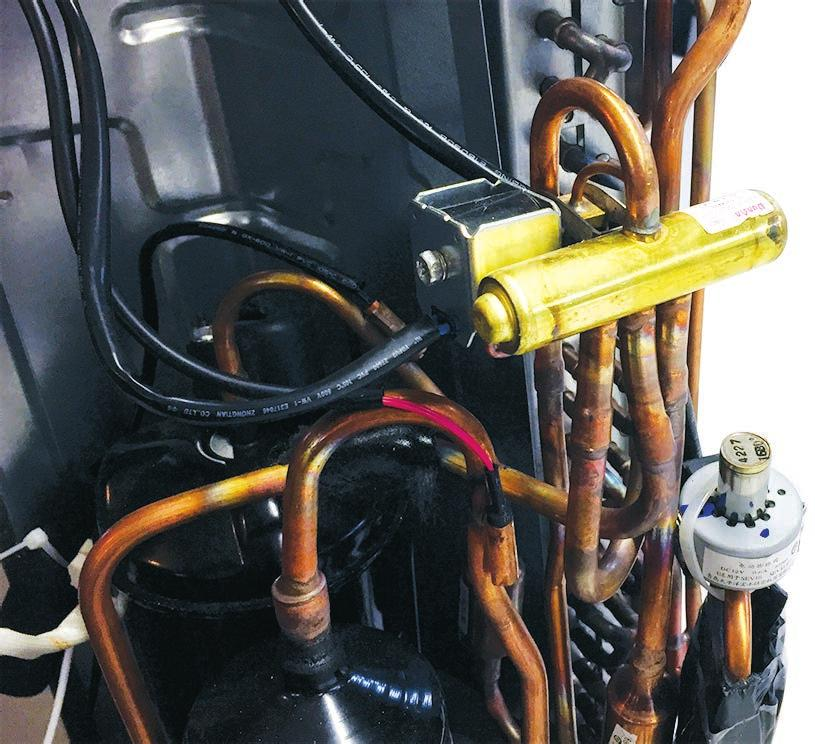 -Way Valve During COOL MODE operation, the valve meters low pressure refrigerant to the indoor coil. During HEAT MODE operation, the valve meters low pressure refrigerant to the outdoor coil.