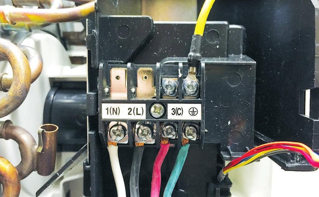 Terminal Block Ambient Temperature Sensor The indoor unit terminal block receives electrical power from the outdoor unit. There are connections for electrical wires.