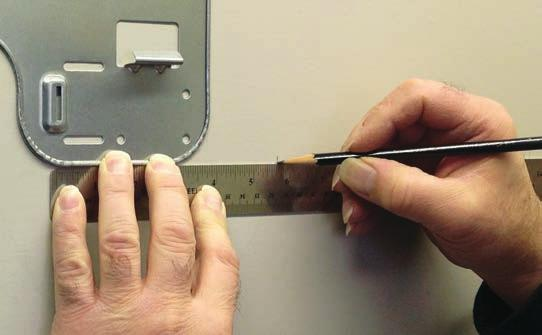 . Step. Screw the mounting plate to the wall.