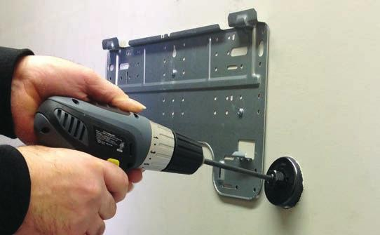7 Install the piping hole cover flange at the hole opening on the inside wall.