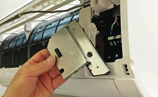 Slide the unit slightly side to side to verify proper placement of the indoor unit on the mounting plate.