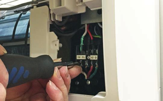 B To make the electrical connections for the indoor unit, two cover plates must be removed.