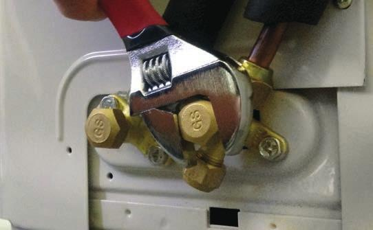 (Illustration 5) Evacuate the system to 50 microns. Close the vacuum pump valve and check the micron gauge.