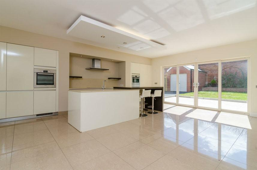 "LUXURY CONTEMPORARY FITTED KITCHEN OPEN PLAN TO LIVING & DINING ROOM AREA: 21' 6"" x 20' 0"" (6.55m x 6.1m) (at widest points)."