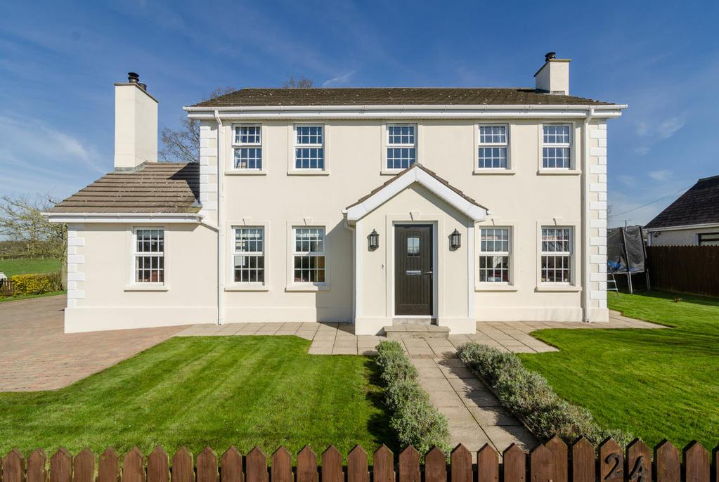 This attractive detached villa has been designed and finished to an extremely high specification and is situated on an excellent site, combining the benefits of countryside rural life and offering