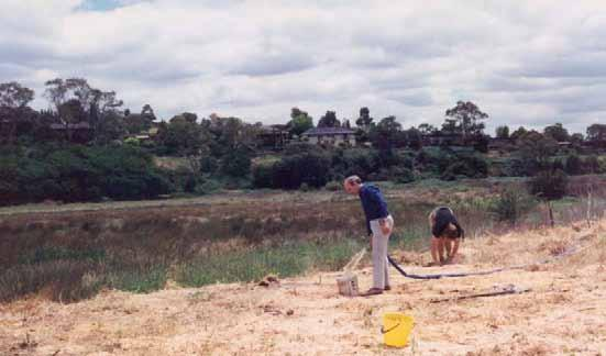 9 Warringal Conservation Society at Banyule Flats Motor pump obtains water from Swamp, Geoff Baker fills bucket.