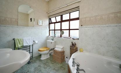 shower cubicle with thermostatically controlled shower unit, heated towel rail, part tiled walls, ceramic tiled floor,