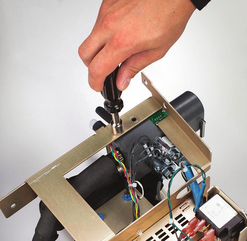 Using the 7/16 wrench, unscrew and remove the thermistor. 7. Disconnect the pressure transducer. 8.