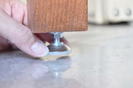 leg(s). Twist the knob on the bottom of table leg up or down until you achieve an even height.