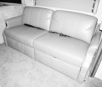 SECTION 9 FURNITURE AND SOFTGOODS REST EASY MULTI-POSITION LOUNGE If Equipped (Typical View Your coach may differ in appearance) Press the Rest Easy Power switch toward the outboard side of the