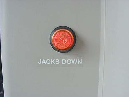 SECTION 10 SLIDEOUT ROOMS AND LEVELING Jacks Down Light The Jacks Down reminder is intended to warn you to retract your Leveling Jacks before moving the vehicle.