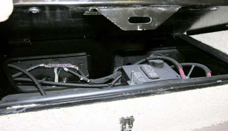 Chassis Battery Models 32D, 37F and 38Q: Located beneath interior entrance step.