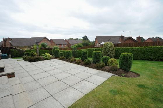 lawns with shrubberies, flowerbeds and