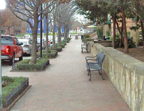 Figure 2-6a Incorporate plantings that define the edges of sidewalks, pedestrian paths and outdoor amenity spaces.