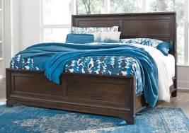 Exclusive) Contemporary group made with Birch veneers and Rubberwood solids in a transitional cherry finish Bedroom pieces feature a floating top design set on picture framed cases