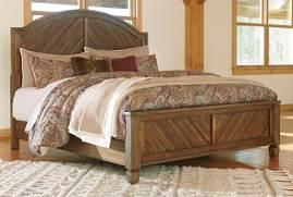 B652 Colestad (Ashley HS Exclusive) Heritage Road group finished in a natural Acacia color with burnished effects Constructed with Acacia veneers and Rubberwood solids Arched panel bed has chevron