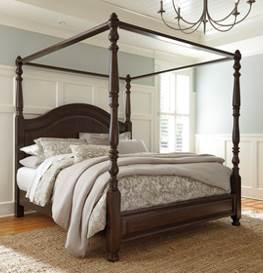B669 Lavidor (Ashley Millennium HS Exclusive) Traditional classic bedroom in a beautiful chocolate brown finish Constructed with birch veneers and poplar solids The 87 high poster