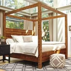 reclaimed lumber in a two-tone bedroom group Combines rustic rubbed black finish with distressed reclaimed lumber finish Made with Acacia veneers