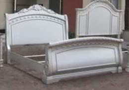 bed has ornamental crown moldings and natural marble caps Velvet upholstered bed is tufted with faux crystals Matching bench, vanity, vanity mirror, and chair are