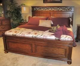 B529 Lazzene (Signature Design) Traditional bedroom made with pine solids and birch veneers in a rich light brown cherry color finish Features fluted pilasters and