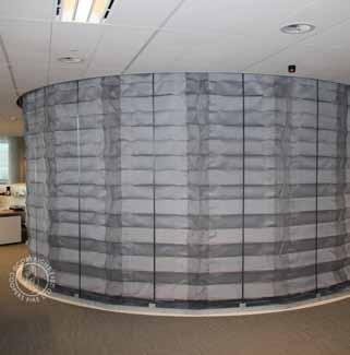 FireMaster Concertina Active Fire Curtain Barriers: Description SMC Coopers FireMaster Concertina Active Fire Curtain Barriers protects WITHOUT the need for CORNER POSTS giving architects,