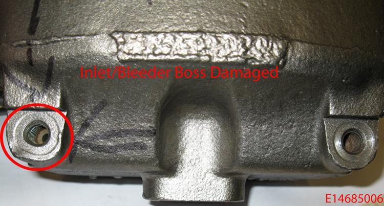 REJECT If the inlet boss (machined area of the casting where the inlet or