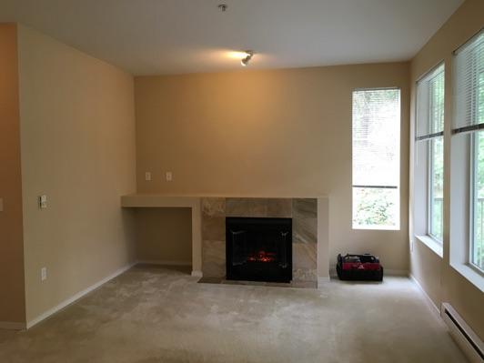 1. Living Room Living Room Walls and ceilings appear in good condition overall.