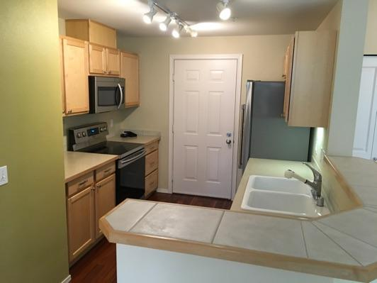 1. Kitchen Room Kitchen Walls and ceilings appear in good condition overall. Flooring is wood. Heat register present. Accessible outlets operate. Light fixture operates.