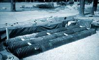 com Corrugated metal pipe for stormwater storage.