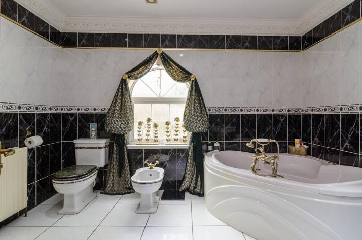 BATHROOM: White suite comprising corner panelled bath with multi jets, mixer tap, telephone hand shower,