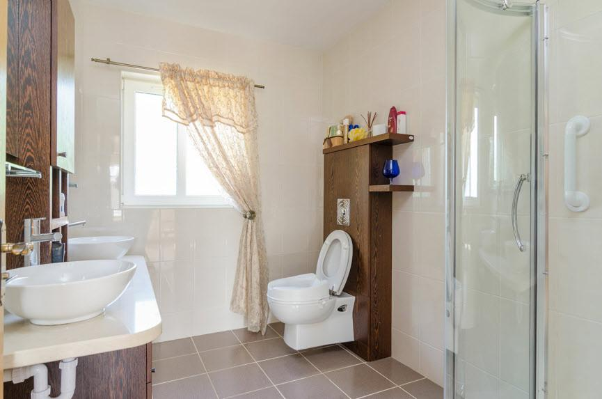 ENSUITE SHOWER ROOM: White suite comprising wc with solid wood frame, vanity unit with twin sinks