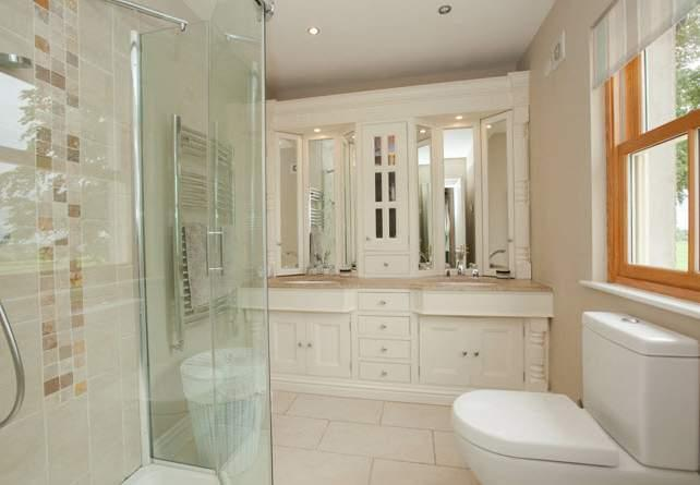 hand shower, low flush WC, hand painted bespoke mirrored dresser unit with marble top