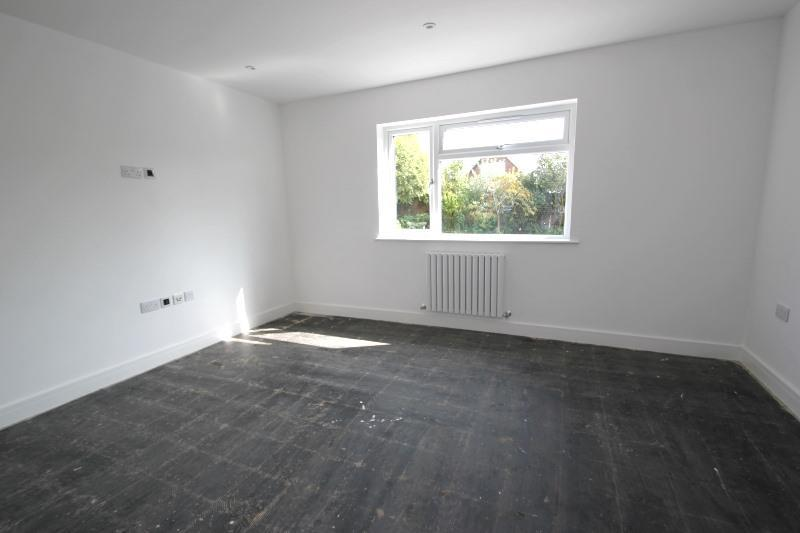 under unit lighting. Low-level w.c. Tiled floor. Frosted double-glazed window to side.
