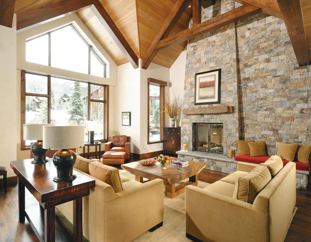 ABOVE: The stone fireplace is a grand centerpiece for this room. Alder beams accentuate the opulent space and contrast with the smoked European Beech ceiling; something of a rarity.