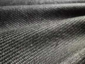 Figure 13. Woven multi-filament geotextile with close-up Woven geotextiles Woven geotextiles are manufactured from various polymers with increasing strengths typically increasing their cost.