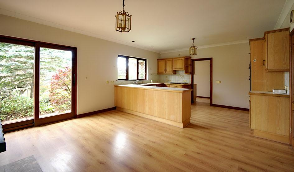 "KITCHEN OPEN PLAN TO CASUAL DINING & LIVING AREA: 21' 4"" x 14' 5"" (6.5m x 4."