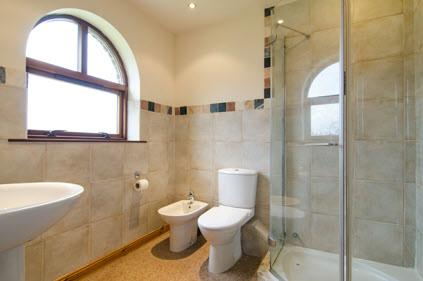 EN SUITE SHOWER ROOM: Comprising fully tiled shower cubicle