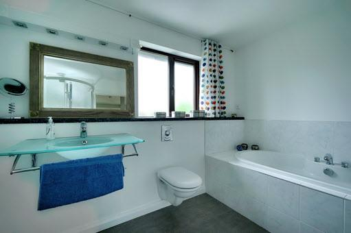 basin, separate fully tiled shower cubicle with Hansgrohe shower unit, heated towel rail, extractor fan.