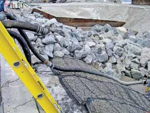 The engineer knew what to do: place geotextile on the subgrade and place armor stone riprap on the geotextile to prevent further scour.