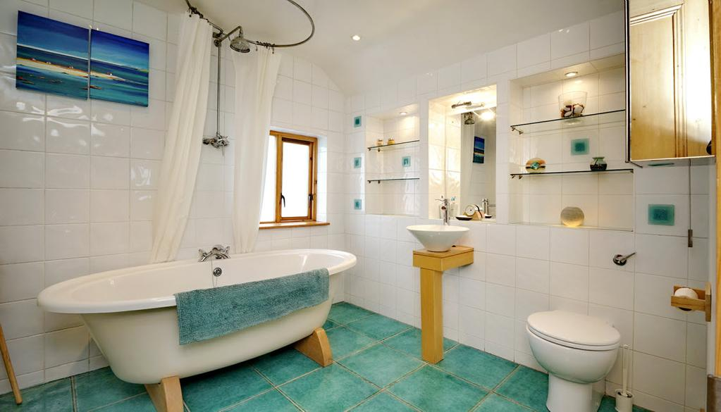 BATHROOM: White bathroom suite comprising free standing oval bath, Bristan thermostatic shower unit with rain shower head, low flush wc,